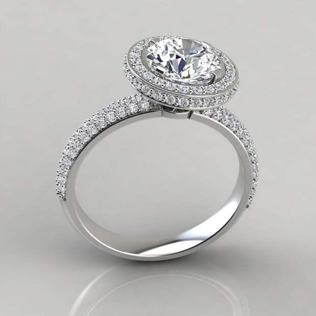Помолвочное кольцо в стиле гало. / Фото: puregemsjewels.com
