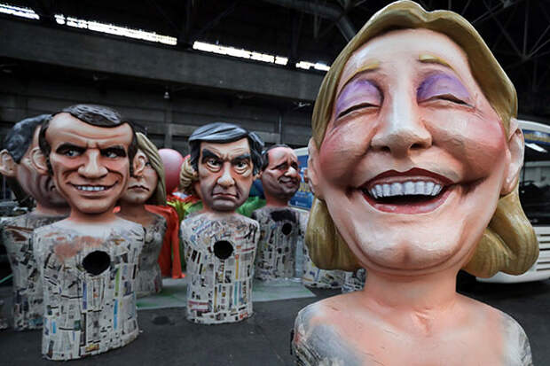 Giant figures of (L-R) Emmanuel Macron, head of the political movement En Marche !, or Onwards !, and candidate for the 2017 presidential election, Francois Fillon, former French prime minister, member of The Republicans political party and 2017 presidential candidate of the French centre-right, and French National Front leader Marine Le Pen, are seen during preparations for the carnival parade in Nice, France, February 2, 2017. REUTERS/Eric Gaillard