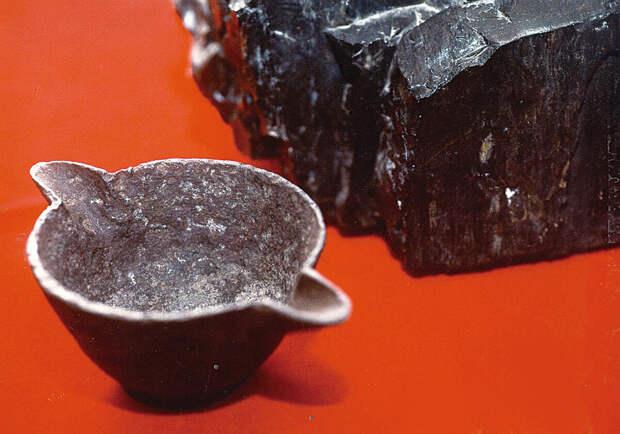 Артефакты древности: железная кружка в угле