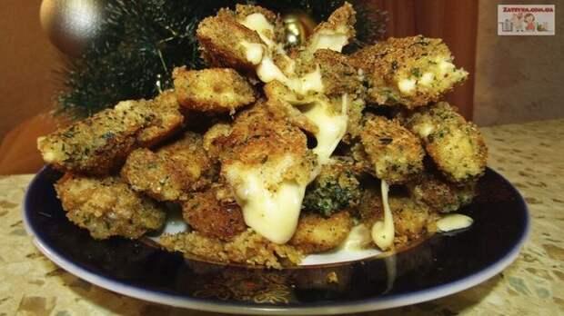 Фото к рецепту: Горячая закуска из сыра в кляре (сырные палочки)