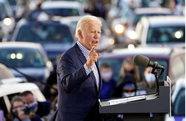 U.S. Democratic presidential candidate Joe Biden speaks during a drive-in campaign event at Dallas High School in Dallas, Pennsylvania, U.S., October 24, 2020. REUTERS/Kevin Lamarque
