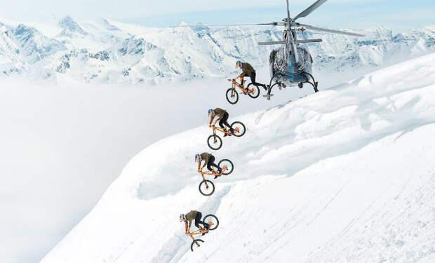 С вертолета на велосипеде. Смельчак поехал вниз с ледника и спуск сняли на видео