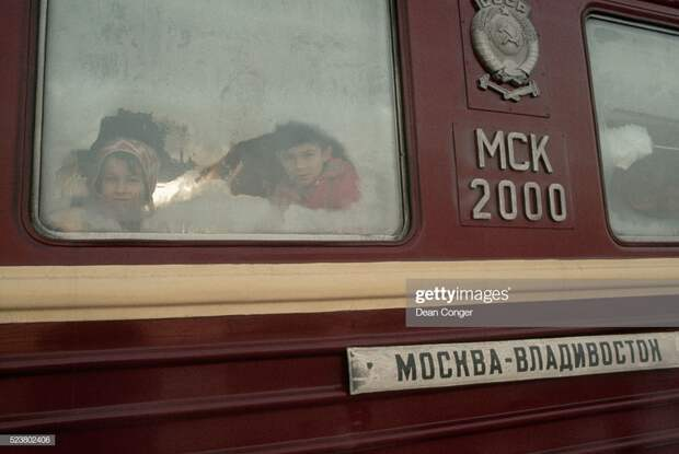 Children Peer Through the Frosted Window of a Trans-Siberian Railway Car : Stock Photo