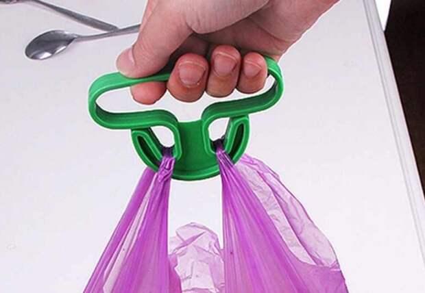 Если пакеты очень тяжелые, держатель тоже может впиваться в руку / Фото: ae01.alicdn.com