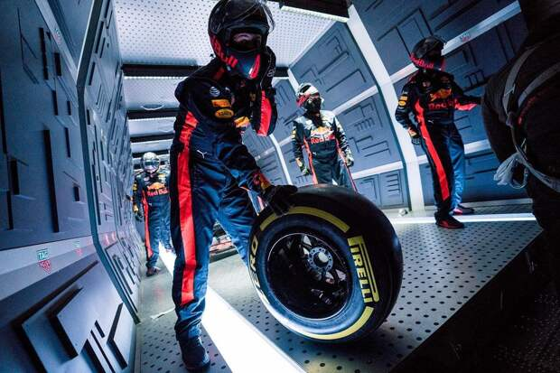A mechanic holding a wheel during Aston Martin Red Bull Racing's Zero-G pitstop aboard an aircraft in Russia.