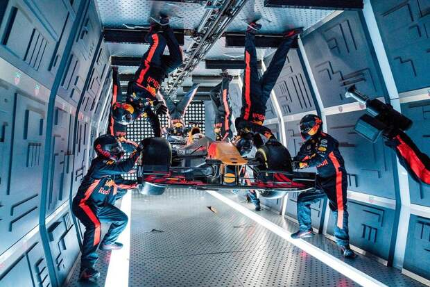 Aston Martin Red Bull Racing's mechanics pictured performing the Zero-G pitstop aboard an aircraft in Russia