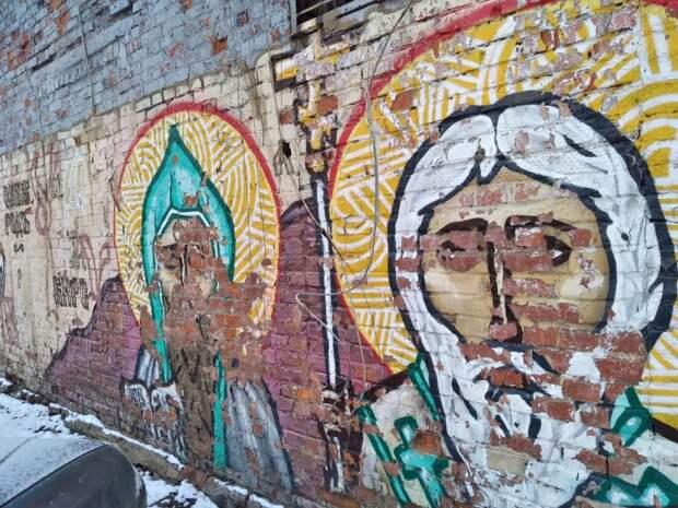 Граффити на Енисейской испугало местную жительницу