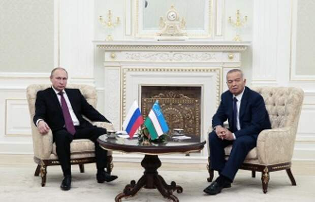 Президент России Владимир Путин и президент Узбекистана Ислам Каримов (слева направо)