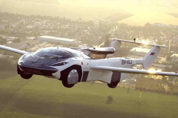 Триумф летающего автомобиля, сгоревшая Тесла и собачий юмор