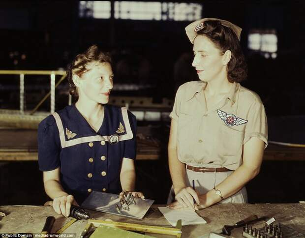Pearl Harbor widows have gone into war work to carry on the fight with a personal vengeance, in Corpus Christi, Texas. Mrs. Virginia Young (right) whose husband was one of the first casualties of World War II, is a supervisor in the Assembly and Repairs Department of the Naval Air Base. Her job is to find convenient and comfortable living quarters for women workers from out of state, like Ethel Mann, who operates an electric drill.