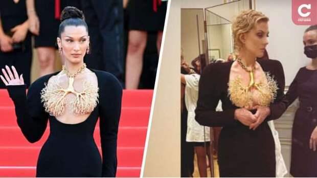 Как Белла Хадид: Рената Литвинова примера черное платье с золотыми бронхами