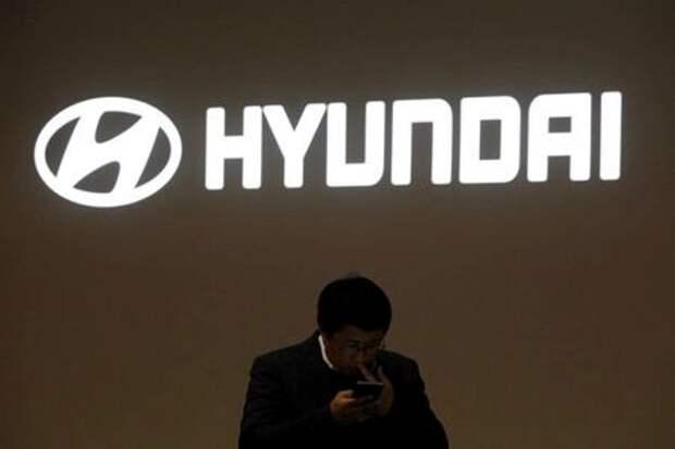 A man walks past the logo of Hyundai Motor during the 2019 Seoul Motor Show in Goyang, South Korea, March 28, 2019. REUTERS/Kim Hong-Ji