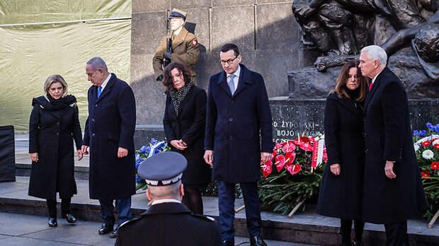 Премьер-министры Израиля и Польши и вице-президент США у мемориала героев Варшавского гетто. Фото: AFP