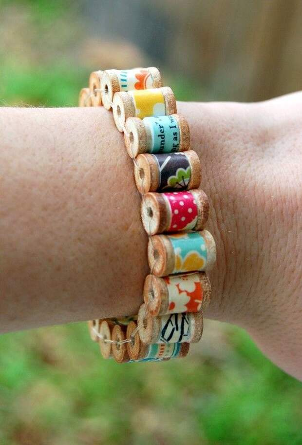 Bracelet of tiny wooden spools with ribbon or thread or embroidery floss wired together as colorful as you like.
