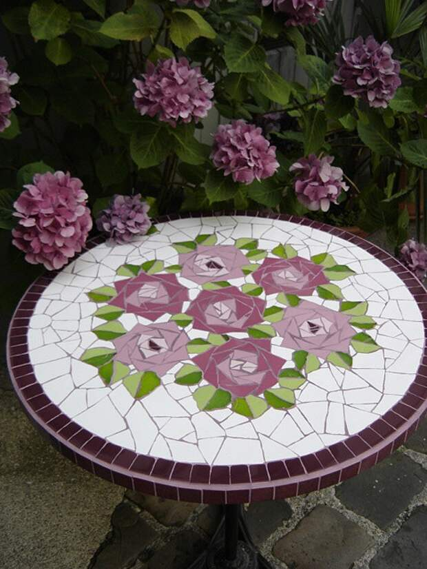 Mosaic patio table top with roses...