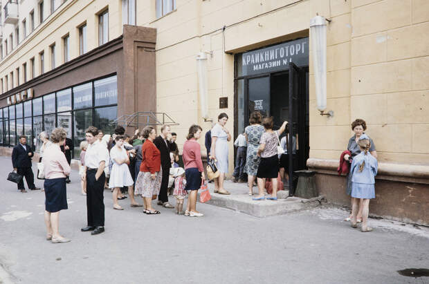 Russia, people waiting in line to enter shop