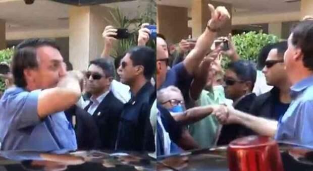Президент Бразилии Жаир Болсонару на улице жмет руку без перчаток во время коронавируса
