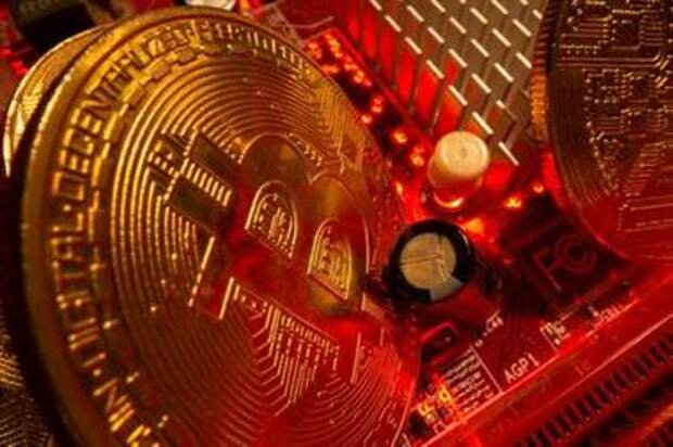 Representations of the virtual currency Bitcoin stand on a motherboard in this picture illustration taken May 20, 2021. REUTERS/Dado Ruvic/Illustration