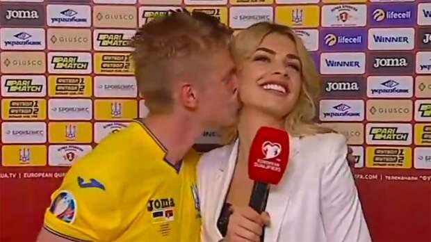 Зинченко страстно поцеловал журналистку впрямом эфире после победы над Сербией